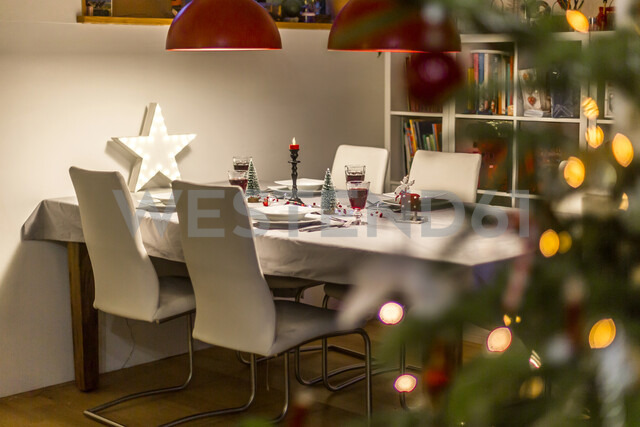Laid table in dining room at Christmas time - SARF03750