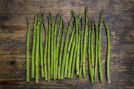 Organic green asparagus spears on wood - LVF06969