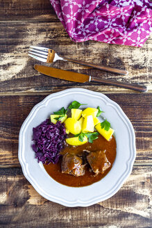 Beef roulade with potato and red cabbage on plate - SARF03753