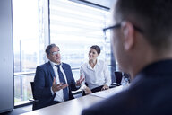 Over shoulder view of businessman explaining at office meeting - CUF06562