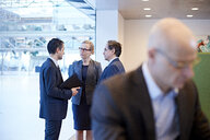 Businesswoman and men meeting in office - CUF06589
