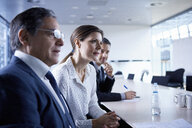 Businesswoman and men listening at office meeting - CUF06613