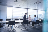 Business team meeting at boardroom table - CUF06664