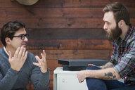 Male designers explaining at design studio meeting - CUF06886