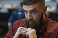 Portrait of tattooed bearded man - CUF06979