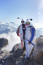 Portrait of two wingsuit BASE jumpers preparing to fly - CUF07522