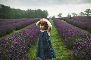 Toddler between rows of lavender, Campbellcroft, Canada - CUF07698