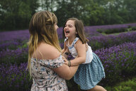 Mother and daughter in lavender field, Campbellcroft, Canada - CUF07701