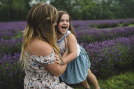 Mother and daughter in lavender field, Campbellcroft, Canada - CUF07704