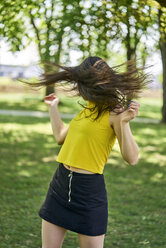 Young woman in park tossing her hair - BEF00059
