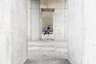 Man stetching at an underpass - DIGF04248