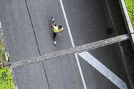 Top view of man running on a street - DIGF04260