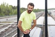 Man stetching on railway bridge - DIGF04266