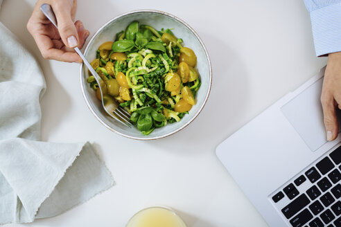 Overhead view of woman with meal using laptop - CUF07854