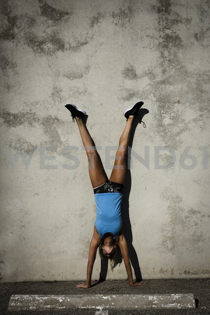 Athlete doing handstand against wall - ISF02056