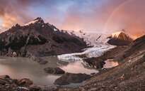 Rainbow and dramatic pink sky over Torre glacier and laguna in Los Glaciares National Park, Patagonia, Argentina - CUF08051