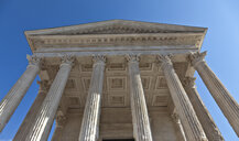 Low angle view of Maison Carree facade, Nimes, Languedoc-Roussillon, France - CUF08132