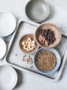 Studio shot, overhead view of cashew nuts, almonds, seeds and dried fruit in bowls - CUF08921