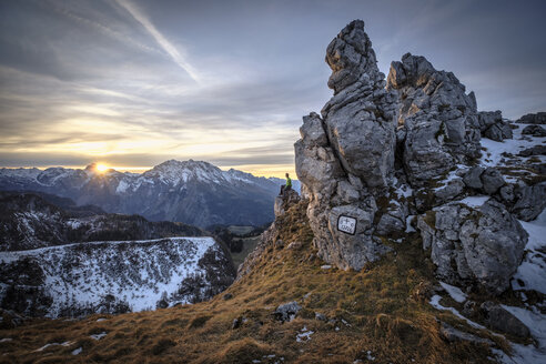 Germany, Bavaria, Berchtesgaden Alps, View to Schneibstein, hiker sitting on viewing point at sunset - HAMF00289