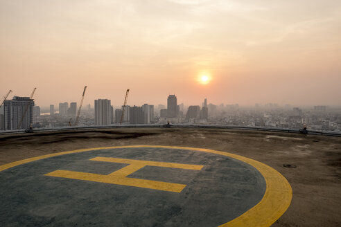 Thailand, Bangkok, helipad on roof top at sunrise - MMIF00075