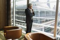 Businessman in coffee area in office, London, UK - CUF08938