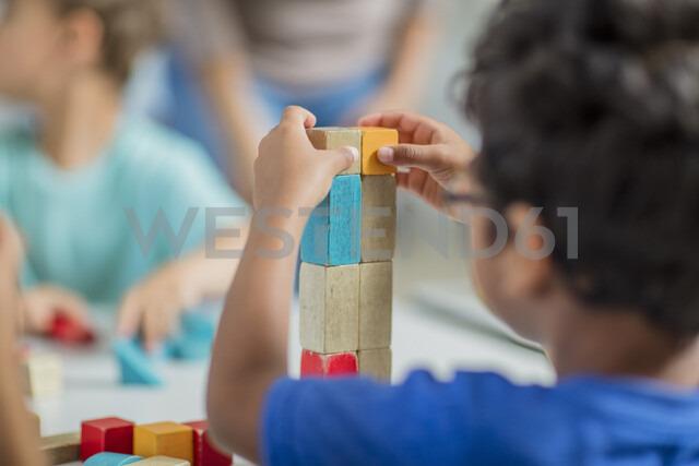 Children playing with building blocks in kindergarten - ZEF15432