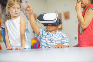 Children in kindergarten with VR glasses - ZEF15459