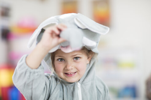 Portrait of happy girl wearing elephant costume in kindergarten - ZEF15468