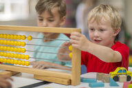 Boys in kindergarten using abacus - ZEF15480