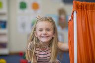 Portrait of happy girl wearing miniature crown in kindergarten - ZEF15483