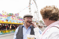 Portrait of happy senior man having fun with his wife on fair - UUF13745