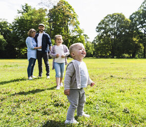 Boy with his family in a park - UUF13808