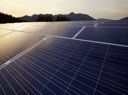 Austria, Tyrol, solar plant at evening twilight - CVF00538