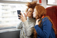 Friends on train, London - CUF09295