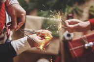 Couple holding indoor sparklers - CUF09637
