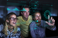 Designers viewing data on futuristic hologram screen - CAIF20592
