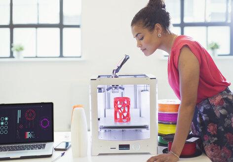 Female designer watching 3D printer - CAIF20598