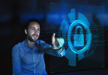 Businessman accessing security feature on futuristic hologram computer - CAIF20619