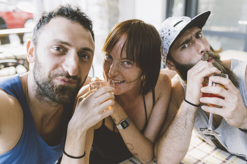 Portrait of three young hipster friends drinking cocktails - CUF10083