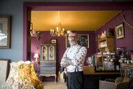 Portrait of quirky vintage senior man in tea rooms - CUF10781