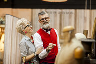 Quirky vintage couple shopping in antiques emporium - CUF10808