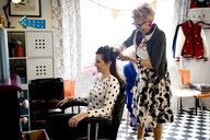 Woman working in quirky hair salon - CUF10972