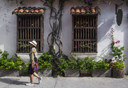 Woman exploring the streets of Cartagena, Bolivar, Colombia, South America - CUF11197