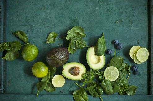 Spinach leaves, avocados and blueberries on green ground - ASF06184