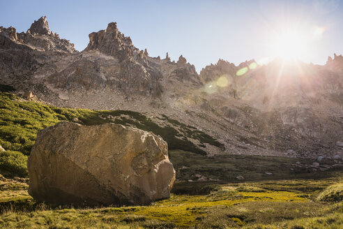 Boulder in sunlit mountain valley, Nahuel Huapi National Park, Rio Negro, Argentina - CUF11587