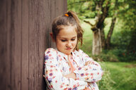 Portrait of little girl pouting mouth - ANHF00055
