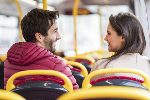 UK, London, happy young couple sitting side by side in bus - WPEF00267