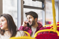 UK, London, portrait of young man on the phone in a bus - WPEF00270