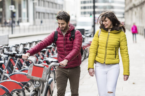 UK, London, young couple with rental bicycle from bike share stand - WPEF00294