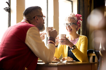 Quirky couple relaxing in bar and restaurant, Bournemouth, England - CUF12372